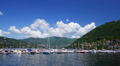 Italy, lake Como landscape with yachts, sky and clouds, time-lapse Footage