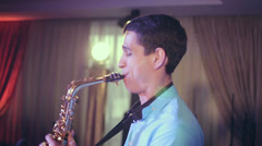 Saxophone player performs on stage with professional light. Profile shot. Stock Footage