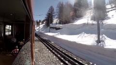 Timelapse outside window view traveling with train in Matterhorn area Stock Footage