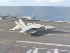 Landing an F18 Hornet on the Aircraft Carrier USS George Washington Stock Footage