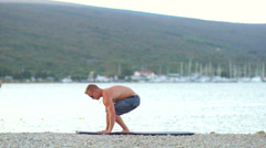 Young Muscular Man Exercises Doing Planks Stock Footage