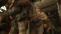 Paratroopers jumping from Hercules parachute Stock Footage
