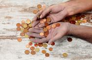 Stock Photo of poor and coins