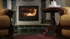 Two chairs near the fireplace - stock footage