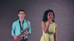 Jazz woman singer and thin saxophone player. The creative duo. Stock Footage