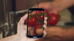 Hand showing cooking clips on smartphone Stock Footage