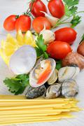 Raw seafood called fasolari with mussels and clams Stock Photos