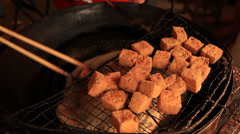 Tofu being deep fried in a wok in Qibao market Stock Footage