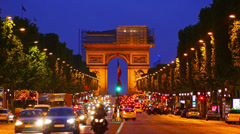 France, Paris, Arch de Triomphe and Champs Elysees traffic at night, time-lapse. Stock Footage