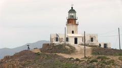 Lighthouse in Mykonos Island in Greece Stock Footage