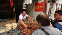 Shanghai Qibao market vendor 14 Stock Footage