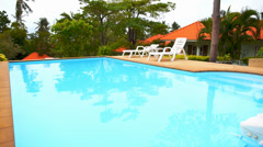 Private Swimming Pool Panorama in Tropical Thailand. Sunny Day on Exotic Island. Stock Footage