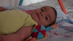 Cute baby waits for play Stock Footage