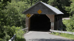 Car driving through covered bridge Stock Footage