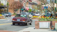 Classic Car Driving into a Vibrant City of Hendersonville NC Stock Footage