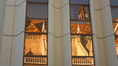 Matthias church's reflection in the windows of the Budapest Hilton Stock Footage