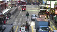 Hong Kong traffic and shoppers time lapse cityscape Red Trams Stock Footage