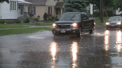 Torrential rain on city street in severe thunderstorm Stock Footage