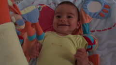Smiling baby on playmat Stock Footage