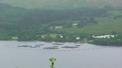 Salmon fish farm on a Scottish loch Stock Footage