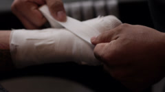 Boxer Taping Hands Before Fight Stock Footage