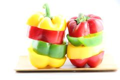 slice the three color of bell pepper in arranged vertically. - stock photo