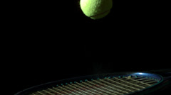 Tennis ball bouncing on a racket Stock Footage