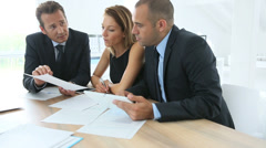 Business people meeting around table in office Stock Footage