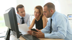 business people working on desktop computer - stock footage