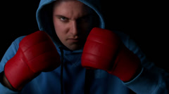 Tough boxer punching fists together with red gloves Stock Footage