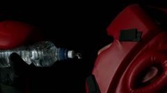 Boxer pouring water from bottle into mouth Stock Footage