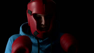 Stock Video Footage of Sporty young man boxing on black background