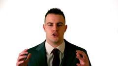 Businessman shouting at the camera on white background Stock Footage