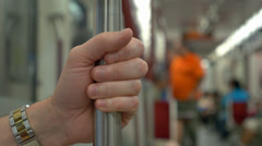 4K Man Holds Rail in Subway Car - stock footage