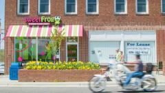 People and Vehicles Passing Frozen Yogurt Shop in Hendersonville NC Stock Footage