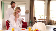 Couple in bathrobes spending the morning together Stock Footage