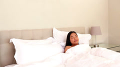 Asian woman waking up and stretching Stock Footage