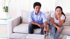 Asian woman fed up as boyfriend ignores her Stock Footage