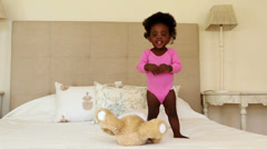 Stock Video Footage of Cute baby girl playing and clapping on bed