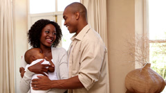 Happy couple holding their baby son Stock Footage