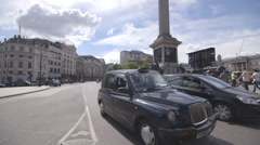 Summer In London - Trafalgar Square black cab - stock footage