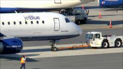 Airplane tow tug JetBlue Stock Footage
