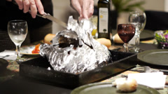Opening a lamb leg from the aluminum paper Stock Footage