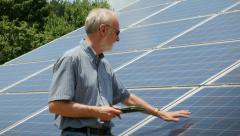 Expert Energy Engineer Counting Solar Power Panels Stock Footage