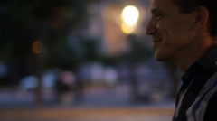 Happy man walking at night. Steadycam shot with 50mm Stock Footage