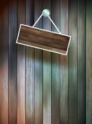 Blank wooden signboard on wall. plus EPS10 - stock illustration