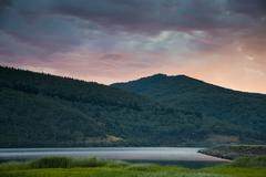 Tranquil view of mountains and lake at dusk, Khancoban, New South Wales, Stock Photos