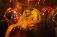Stock Photo of Couple dancing together in nightclub