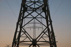 Low angle view of electricity pylons against clear sky Stock Photos