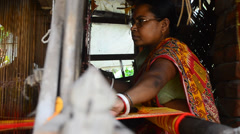 Indian woman preparing handloom tant saree Stock Footage